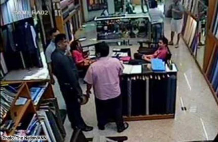 Caught on camera: Cops demand ang pao from shop