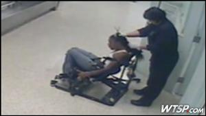 Video shows police officer cutting woman's hair weave