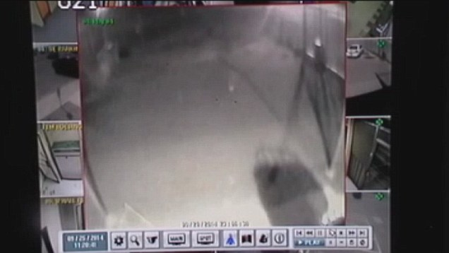 Caught on camera: 'Ghost' walks outside police station