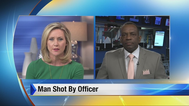 Man shot by officer